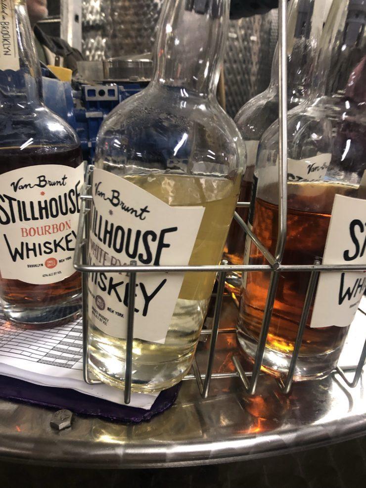 3 bottles of different Van Brunt whiskeys.