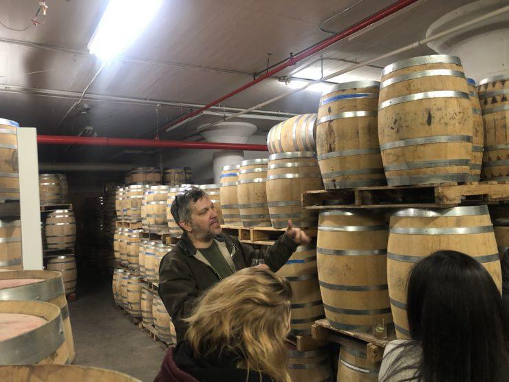 Daric with barrels in the distillery.