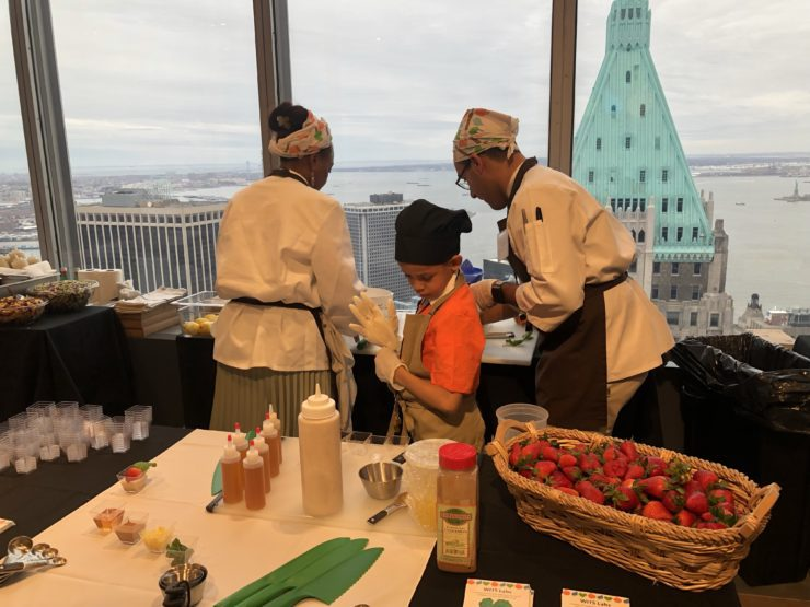 2 chefs and a student assembling desserts at the dessert station.