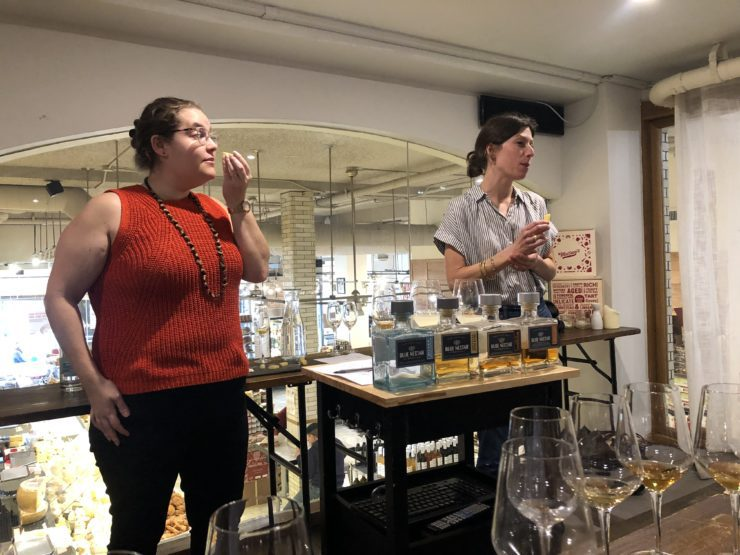 Tess Lampert and staff member leading the tasting and smelling cheese.