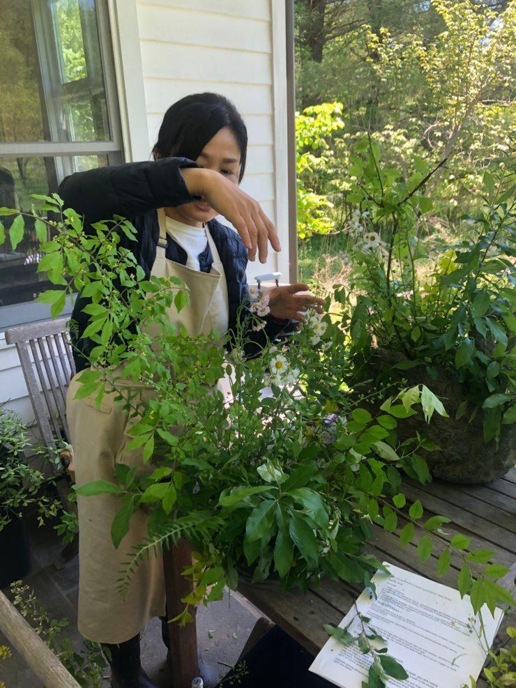 Akiko arranging greenery.