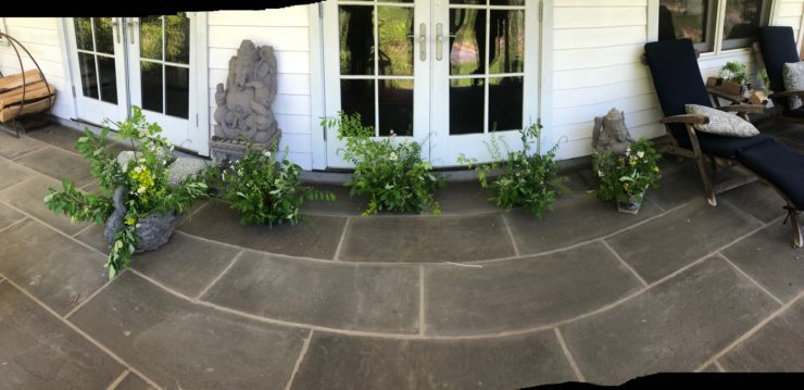 All the ikebana creations in a row in front of the house.