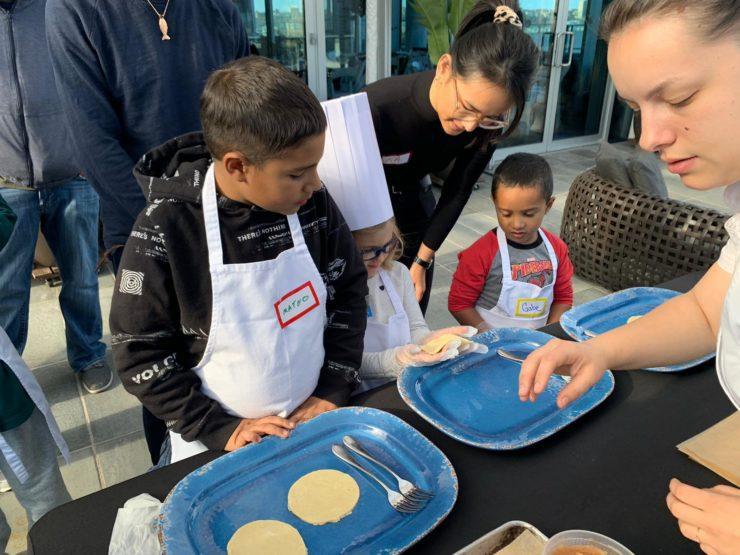 Chef Sofia helps children make hand pies.