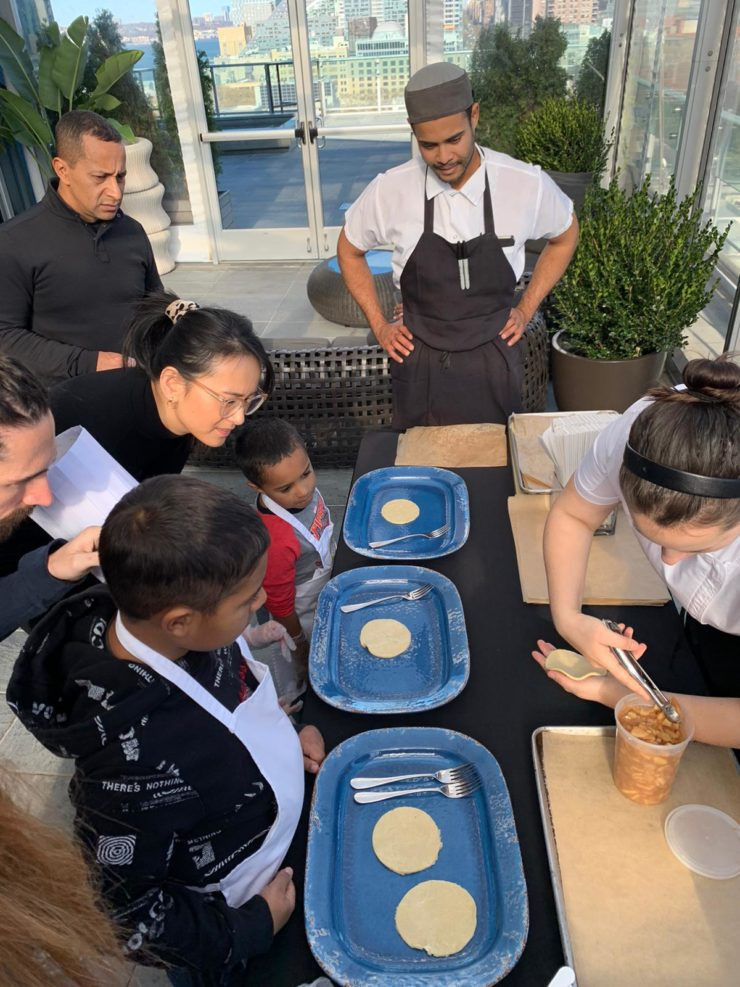 Chef Sofia shows children how to fill hand pies.