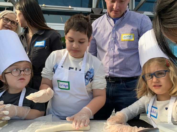 Students work on rolling out dumpling dough.