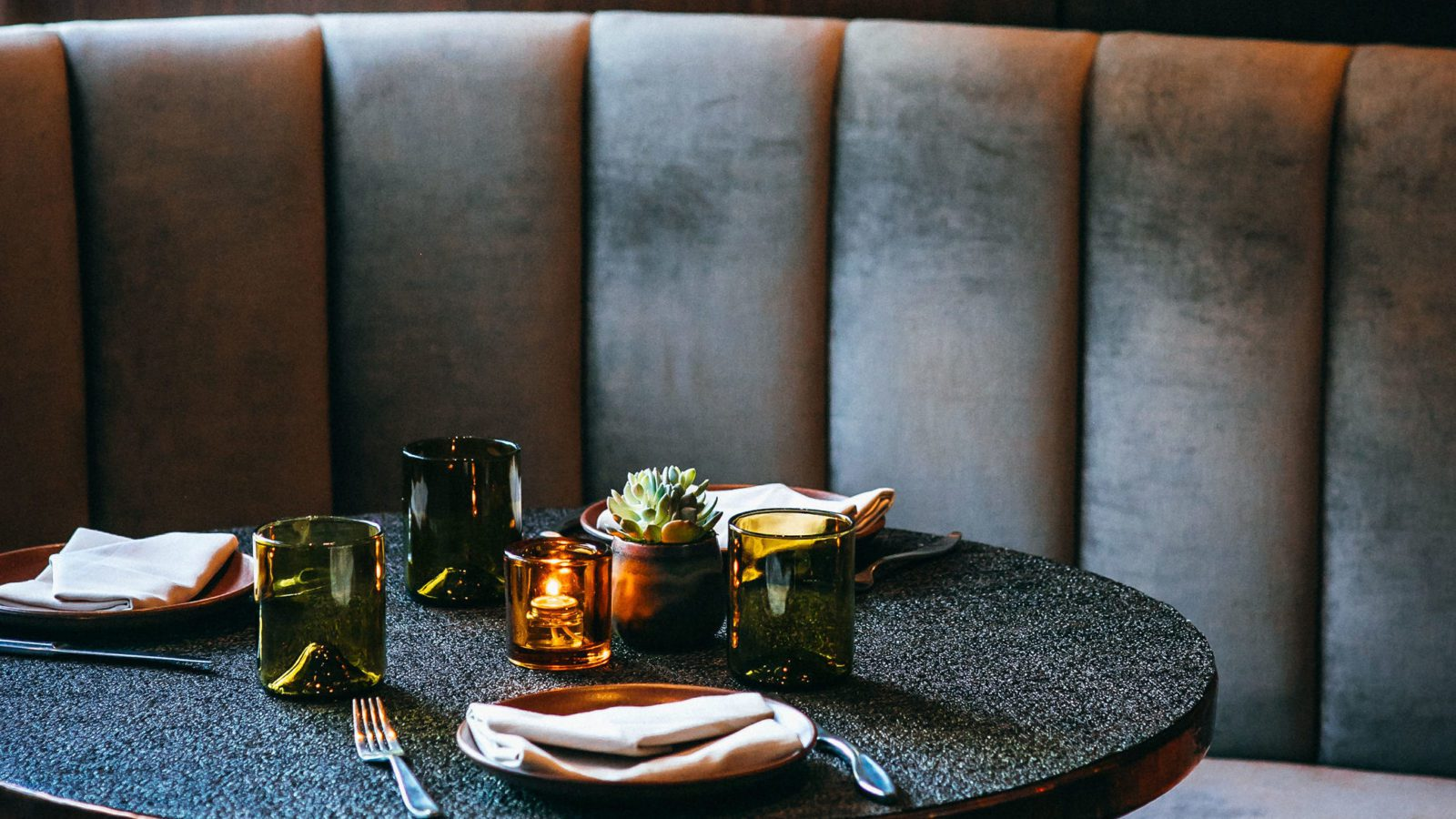 Round banquette with place setting.