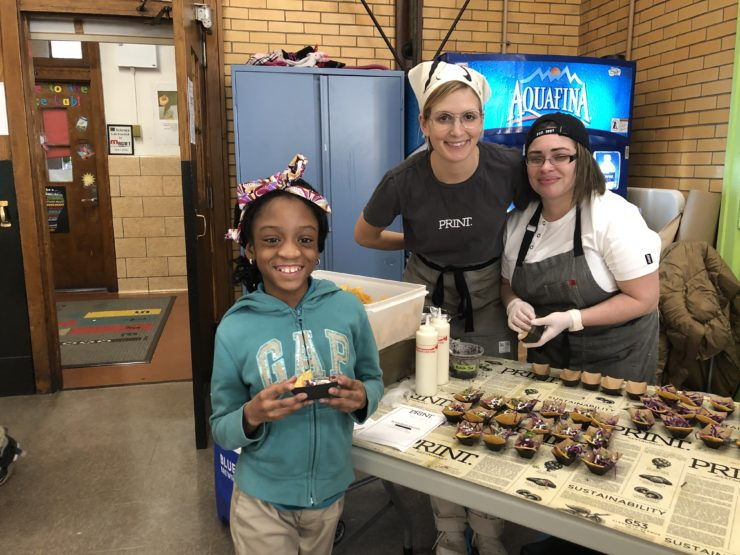 Meghan and Kimberly with student at Wellness in the Schools event.